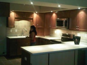 Woman in newly renovated kitchen.