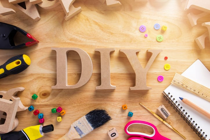 DIY Wood Font Style On a Wooden Workbench Top View. Home Improvement Do it Yourself concept