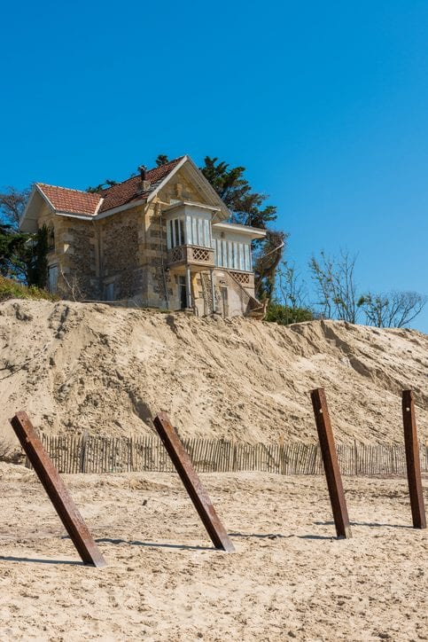House on dunes with strong erosion of dunes by the ocean