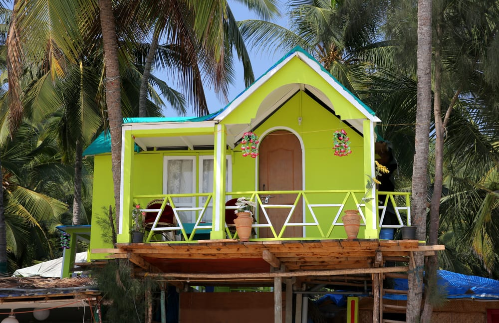 Colourful hats on sandy beach by the sea, Guest house or ADU, short for Accessory Dwelling Unit.